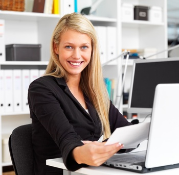 Portrait of a happy young  business woman working in office